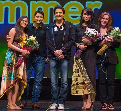 Marzi Pestonji on stage with Shiamak Davar at an event