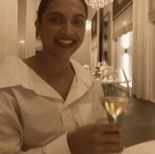 Deepika Padukone holding a glass of wine