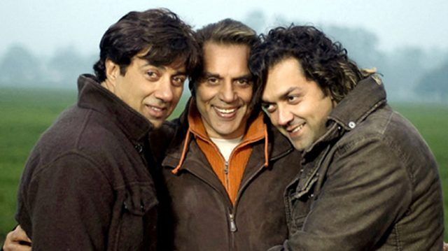 Dharmendra with Sunny Deol (left) and Bobby Deol (right)