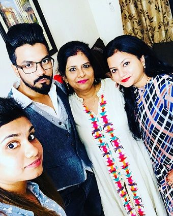Rocky Jaiswal with his mother and two sisters