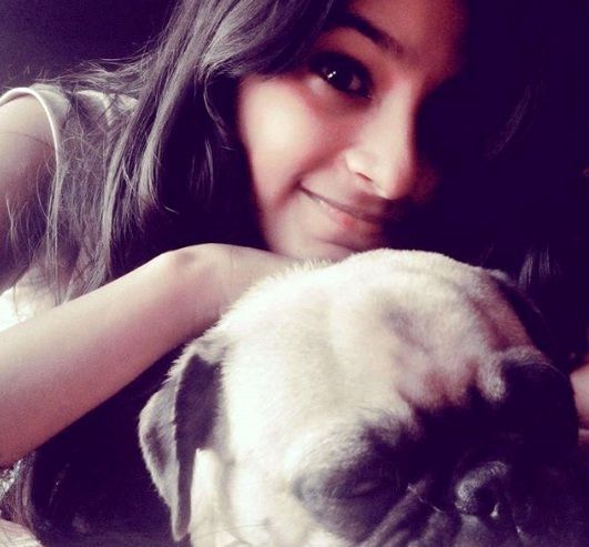 Anukreethy Vas with her dog