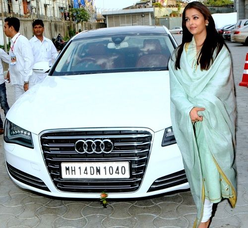 Aishwarya Rai Bachchan poses with her Audi A8 car