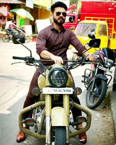 Basheer Bashi poses with his Royal Enfield bike