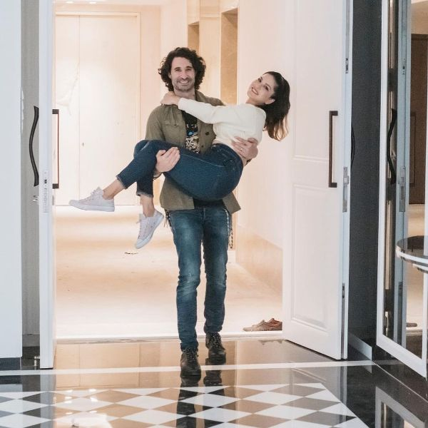 Daniel Weber carrying Sunny Leone in his arms as they happily enter their new house in Mumbai