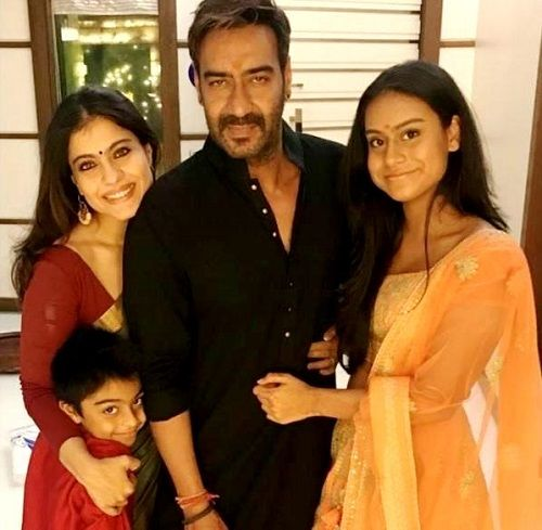 Kajol with her husband Ajay Devgn and children