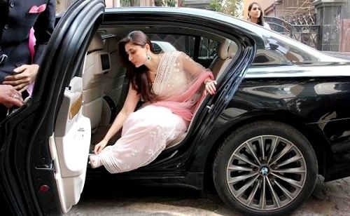 Kareena Kapoor poses with her BMW 7 Series car
