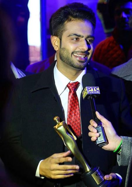 Mankirt Aulakh with award