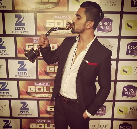 Zain Imam with award