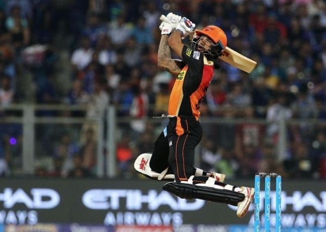 Shikhar Dhawan taking a shot in IPL