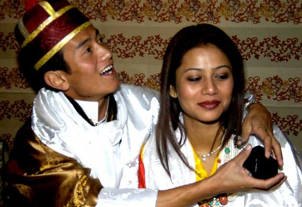 Baichung Bhutia with his wife