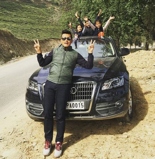 Bhaichung Bhutia with his car and children
