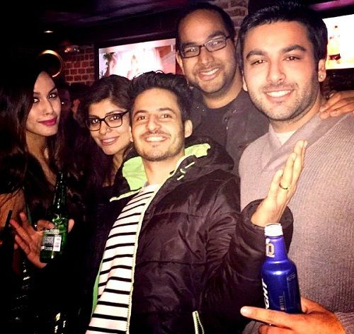 Mohit Malhotra with a bottle of alcohol