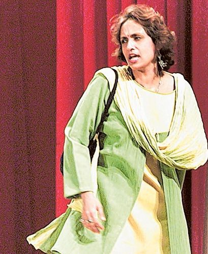 Swaroop Sampat performing a play in a theatre
