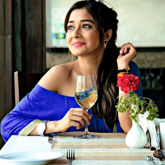 Tina Datta with a glass of wine