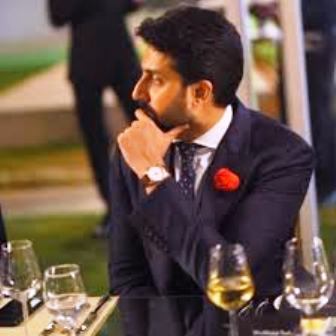 Abhishek Bachchan with a glass of wine