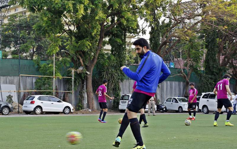Abishek Bachchan playing football