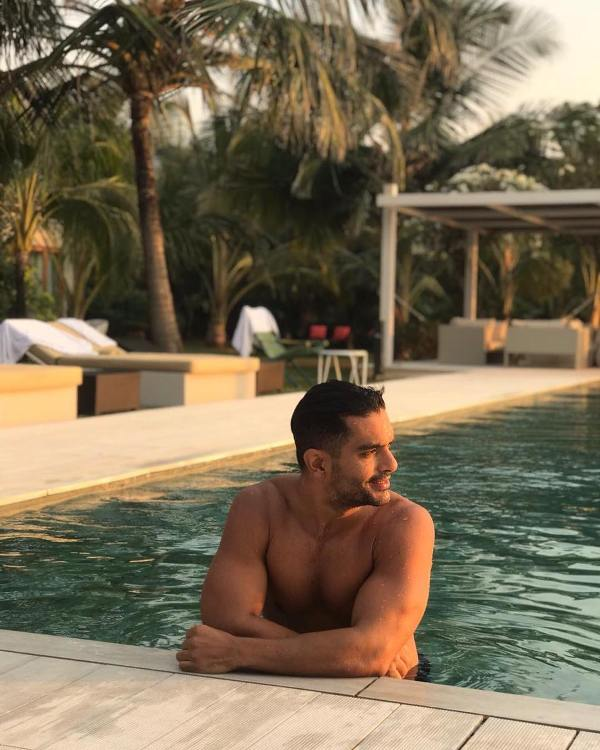 Angad Bedi swimming