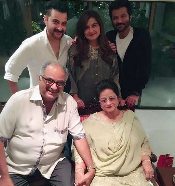 Anil Kapoor (right) with Boney Kapoor (seated), Sanjay Kapoor (left), Reena Kapoor (center), and his mother