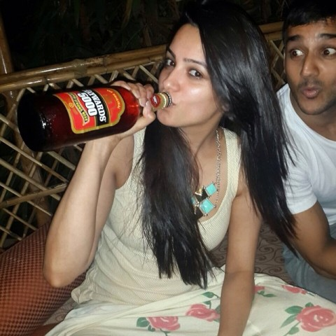 Anita Hassanandani with a bottle of alcohol