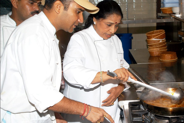 Asha cooking at her restaurant in Dubai