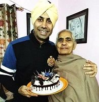 Binnu Dhillon with his motherpressed