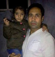 Binnu Dhilon with his daughter