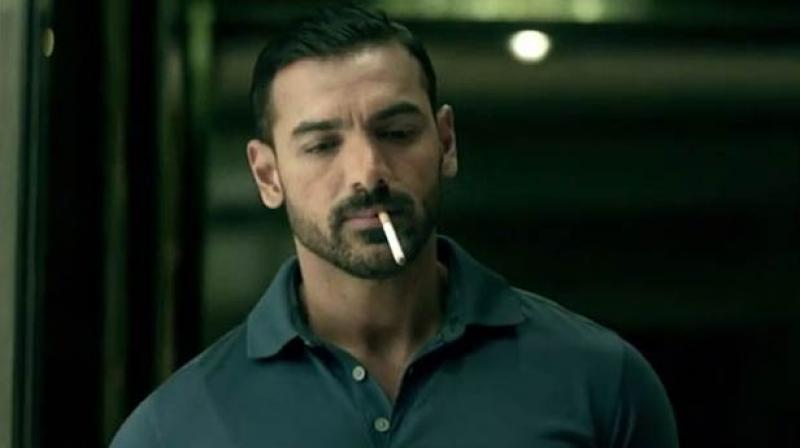 John Abraham smoking for a scene in Dishoom