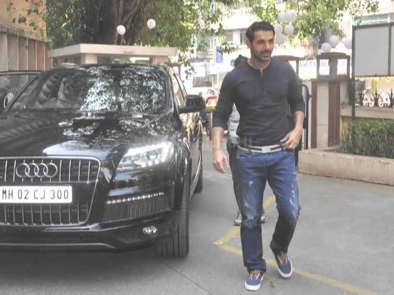 John Abraham with his Audi Q7