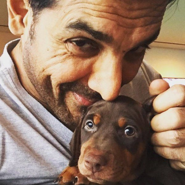 John Abraham with his pet dog
