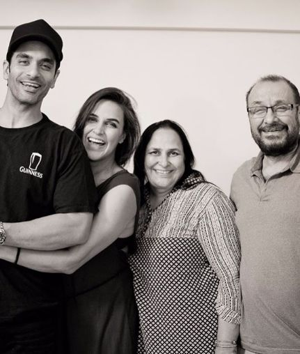 Neha Dhupia With Her Brother And Parents