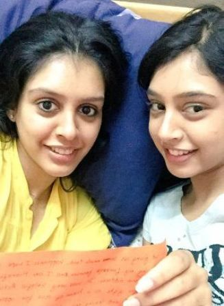Niti Taylor with her sister
