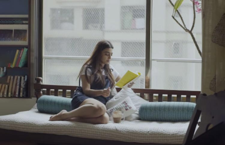 Radhika Apte reading a book