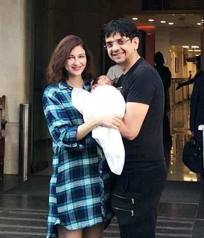 Saumya Tandon with her husband and son
