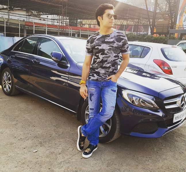 Sharad Malhotra in front of his car