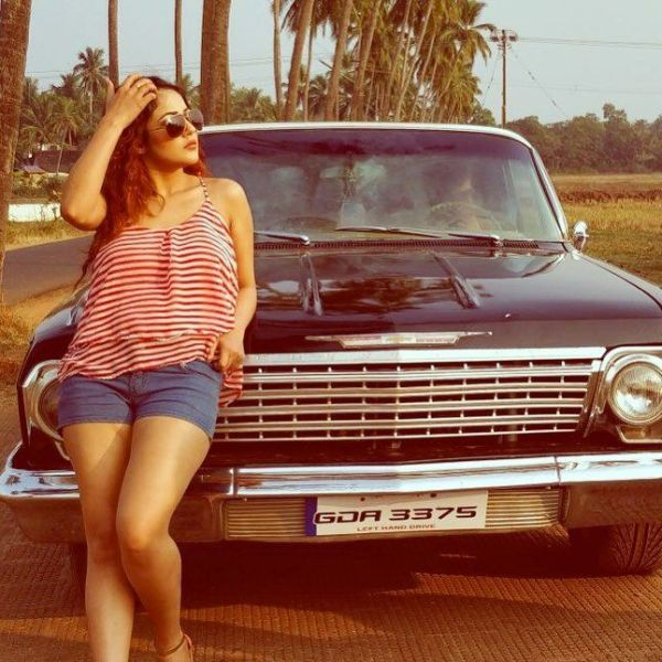 Shehnaz Kaur Gill posing with car