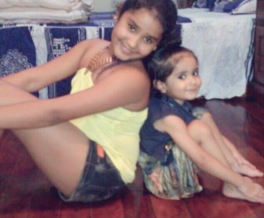 Young Chahat with her sister, Aanchal Tewani
