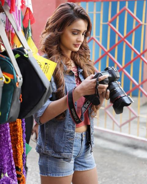 Aarushi Sharma with a camera