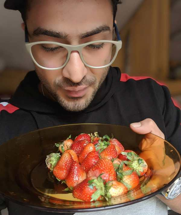 Aly Goni having strawberries