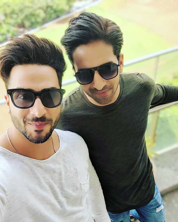 Aly Goni with his brother