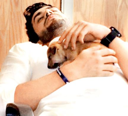 Aly Goni with his pet dog