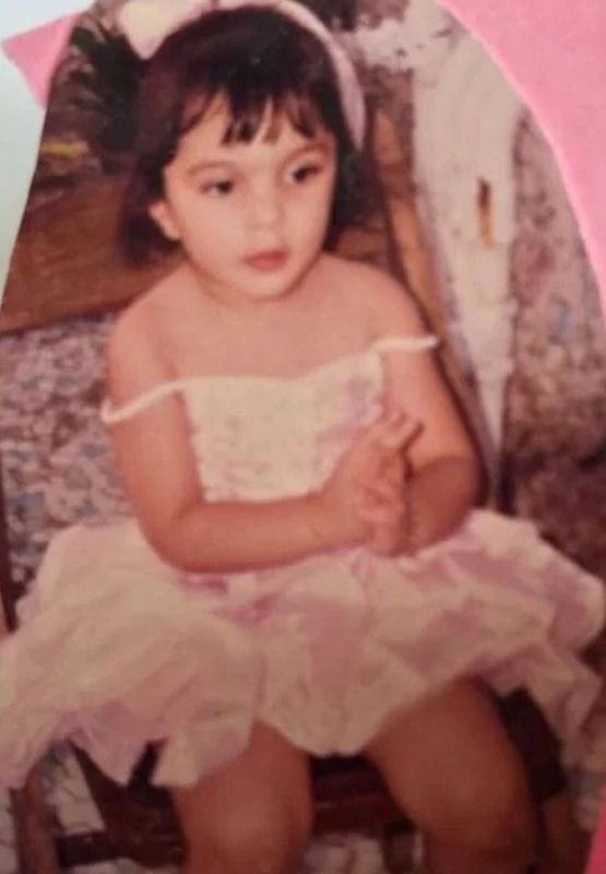 Kiara In An Off-Shoulder Dress In A Photo From Her Childhood