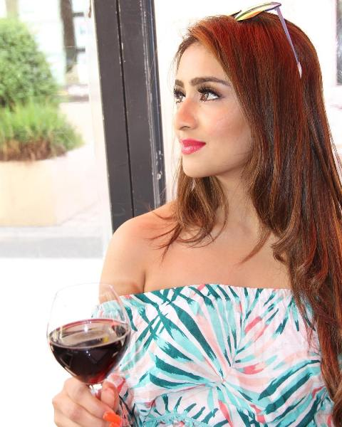 Musskan Sethi with a glass of wine