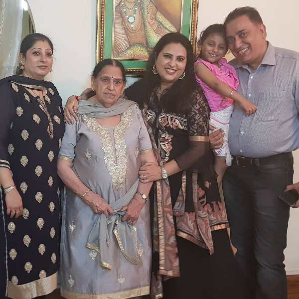 Nilu Kohli with her mother and brother