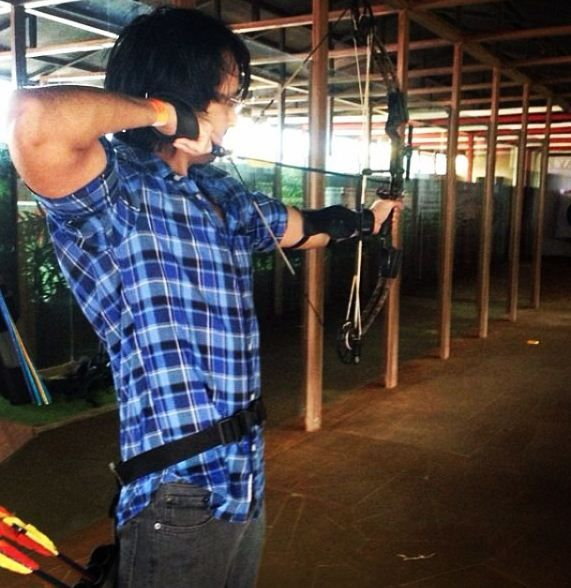 Priyank Sharma playing archery