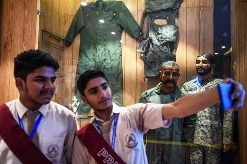 Students taking a selfie with the mannequin of Abhinandan Varthaman in Pakistan