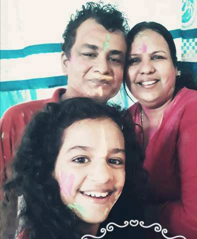 Syna Anand with her parents on holi