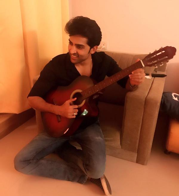 Adhvik Mahajan playing the guitar