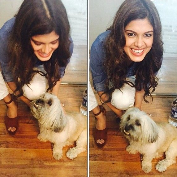 Asha Bhat playing with the puppy