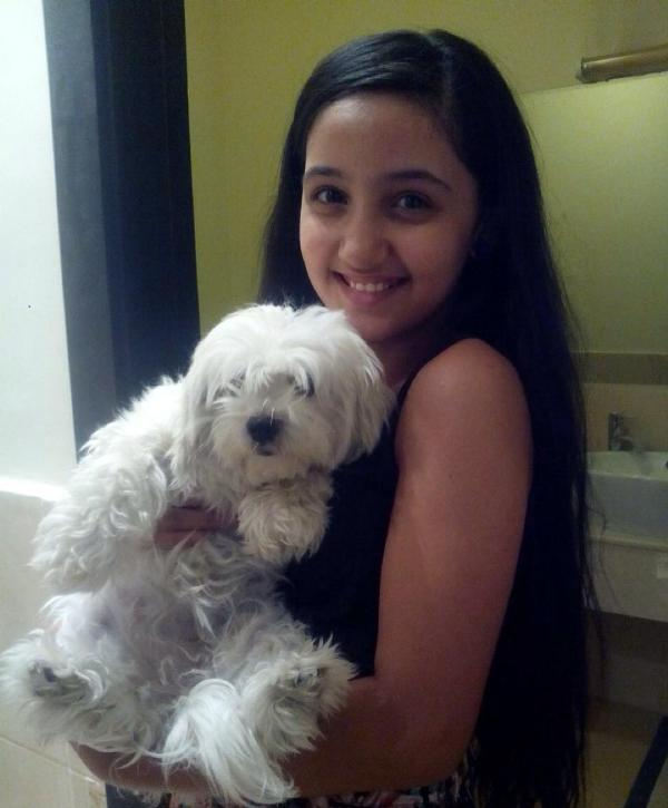 Ashnoor Kaur with her dog