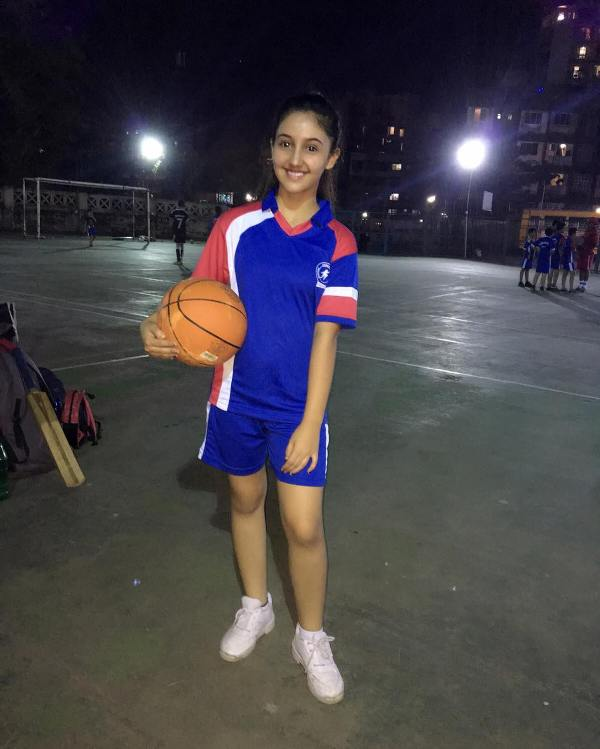 Ashnoor kaur posing with basketball